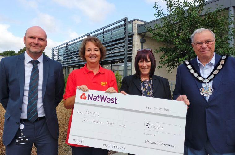Chaplains receive cheque from Wealden Crematorium on Eastbourne Bournefree website